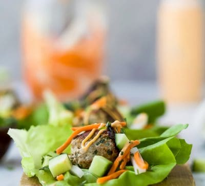 Quick Easy Banh Mi Lettuce Wraps a healthy low carb version of the famous Banh Mi Sandwich! Asian inspired turkey meatballs served on a lettuce wrap with pickled vegetables and sriracha mayo! It's dinner perfection! #glutenfree