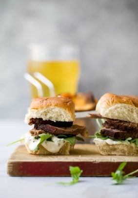 Beer Braised Slow Cooker Brisket Sliders tender moist brisket served on Hawaiian rolls then slathered with a creamy horseradish aioli. This easy flavorful appetizer is sure to be devoured as soon as it hits the table!