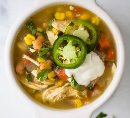 Healthy Crock Pot White Chicken Chili with a Salsa Verde twist! This easy comforting soup is filled with flavor, less than 220 calories a serving and guaranteed to be a favorite! #glutenfree