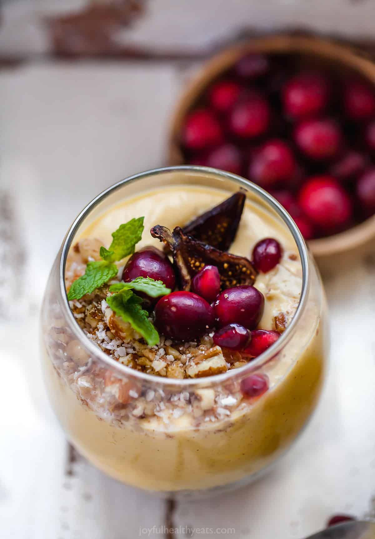 healthy pumpkin pie yogurt parfait in a parfait glass