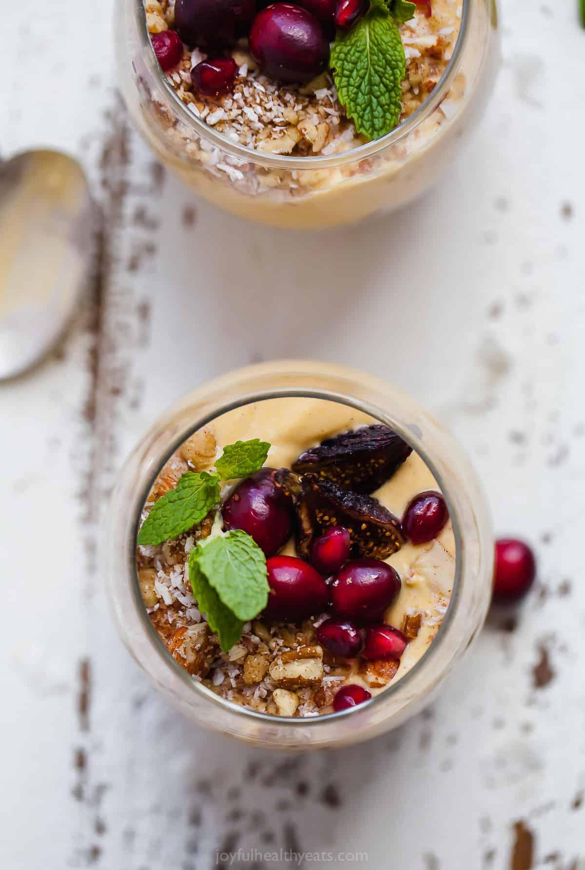 overhead photo healthy pumpkin pie yogurt parfait in a parfait glass with mint