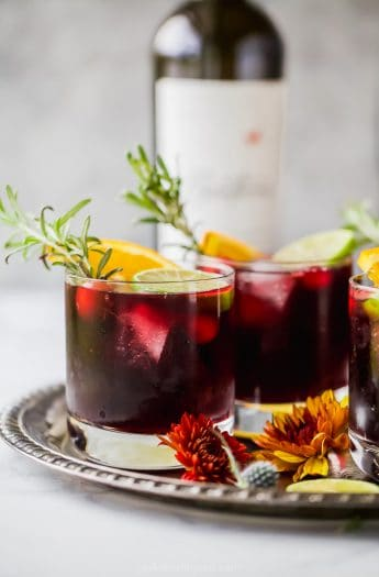 photo of holiday cranberry sangria with rosemary in a glass