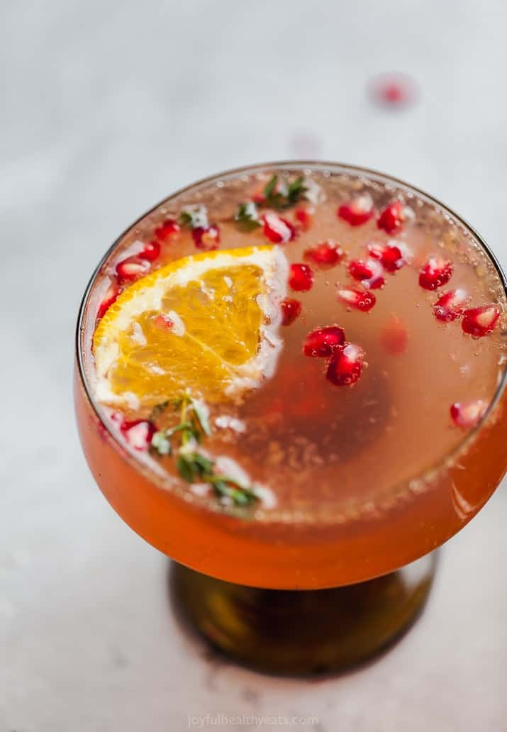 side view of holiday pomegranate gin cocktail
