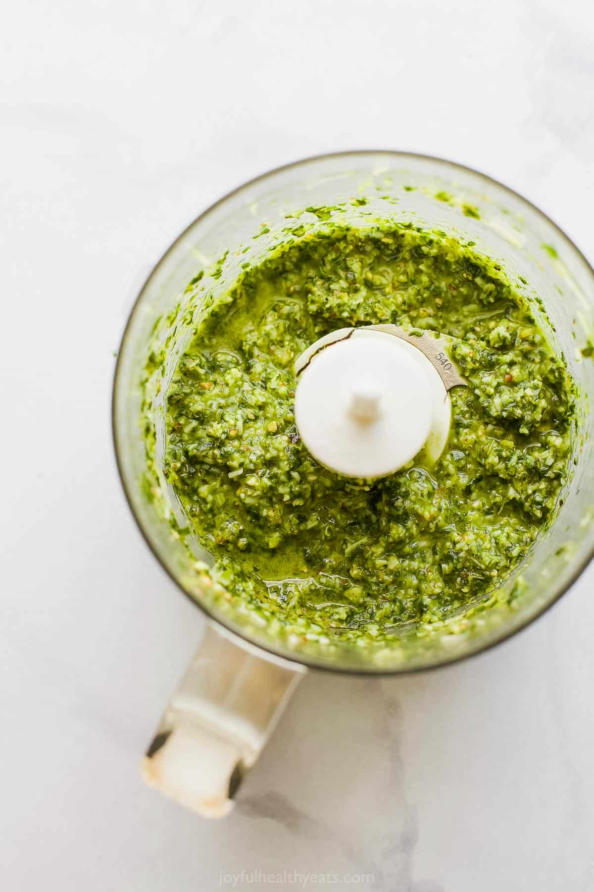 picture of basil pesto in a food processor