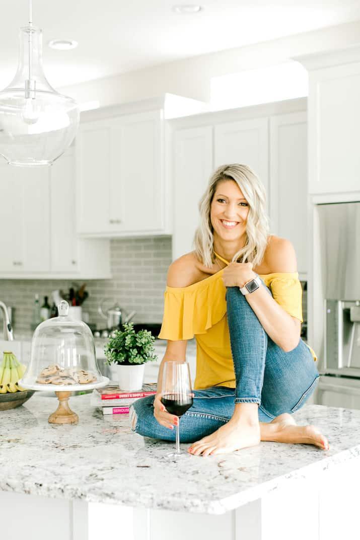 Krista sitting on her kitchen counter