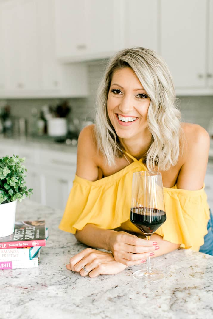 Krista Rollins with a glass of red wine