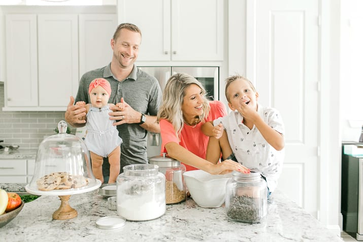 Krista with husband and two children in the kitchen