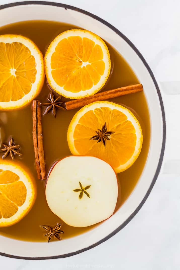 hot spiked mulled apple cider in a big dutch oven pot