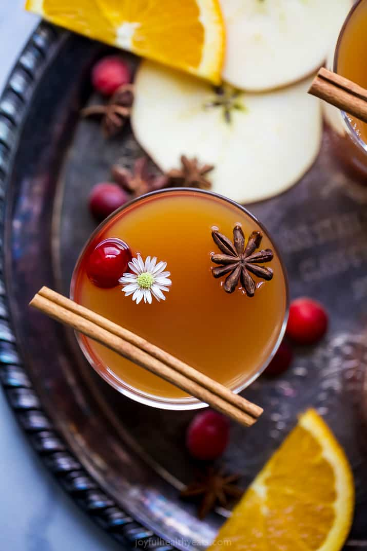 overhead photo of hot spiked mulled apple cider in a cup with garnish