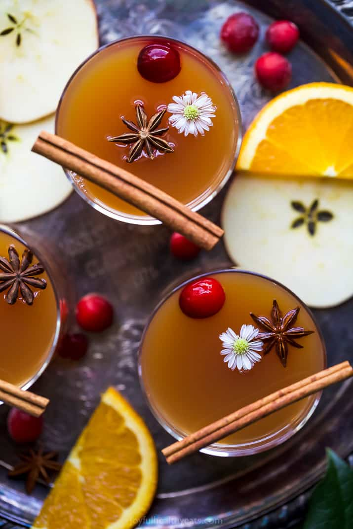 overhead photo of hot spiked mulled apple cider recipe in cups