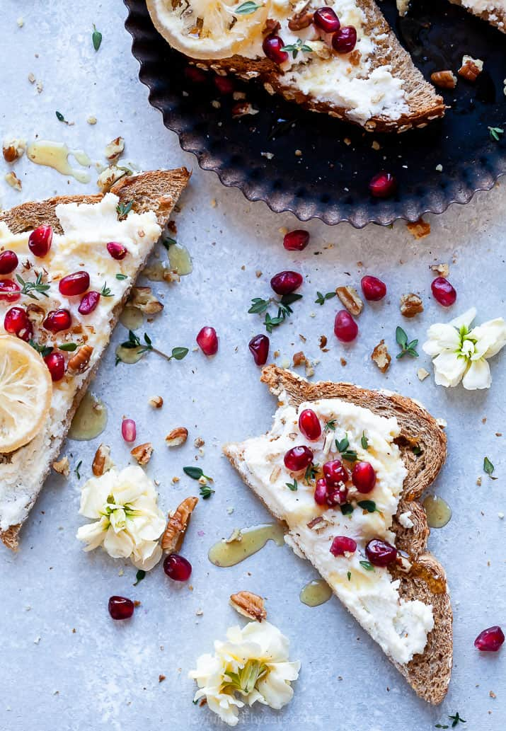 overhead photo of pomegranate honey ricotta toast