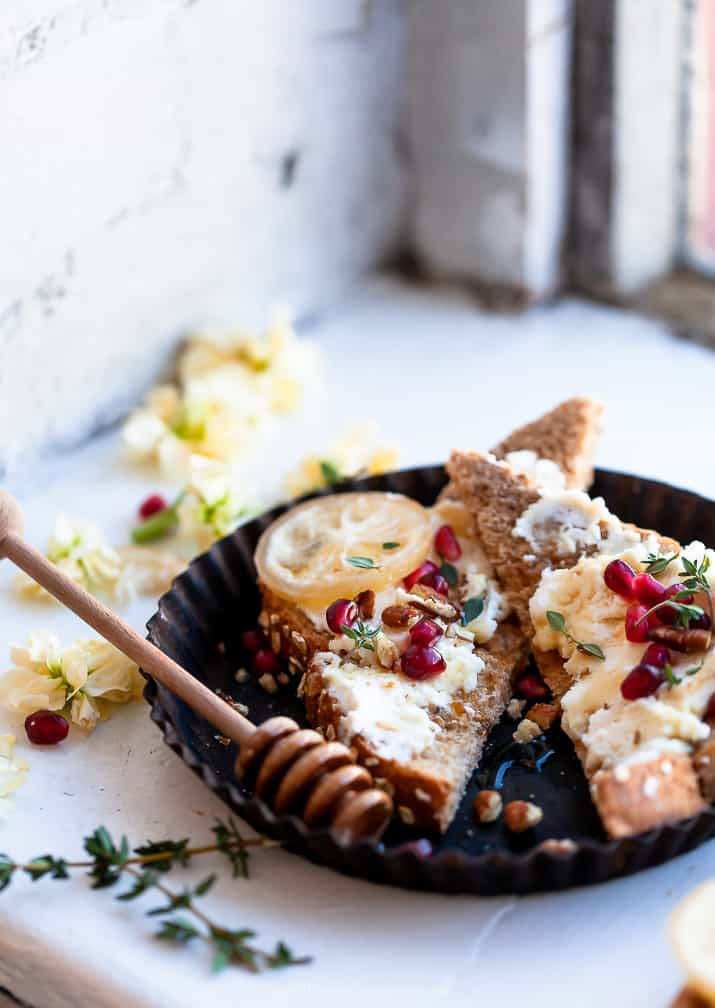 photo of pomegranate honey ricotta toast sitting on window sill