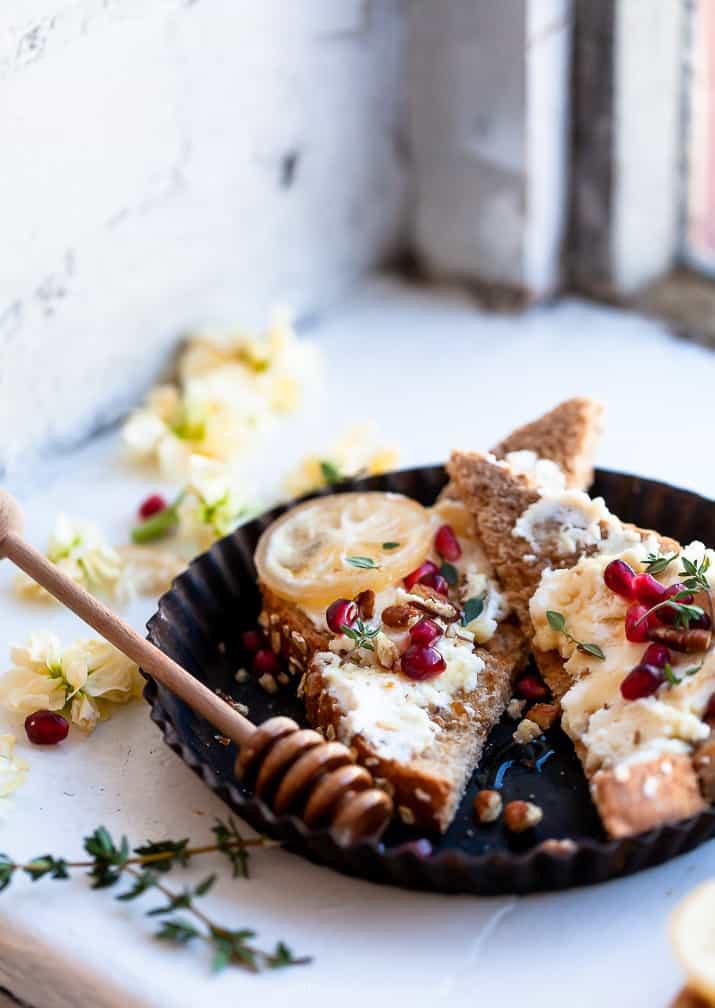 photo of pomegranate honey ricotta toast sitting on window sill
