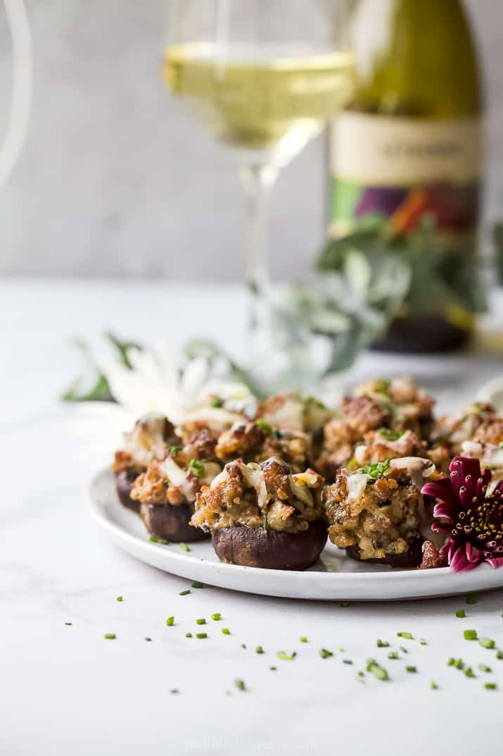 photo of cheesy sausage stuffed mushrooms on a plate