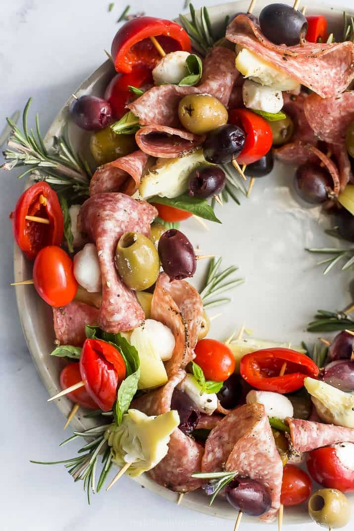 close up overhead photo of christmas wreath antipasto skewers