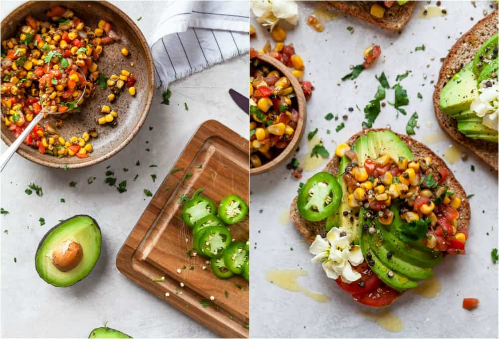 charred corn salsa in a bowl and a halved avocado next to a finished avocado toast topped with the corn salsa