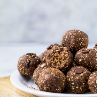chocolate brownie energy balls piled on a plate