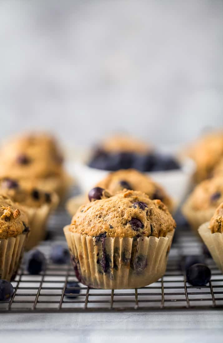 picture of healthy banana blueberry muffins on a cooling rack