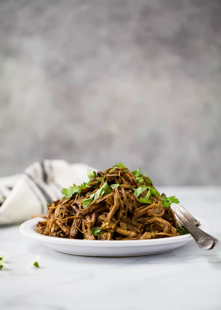 photo of healthy instant pot chipotle beef barbacoa on a plate