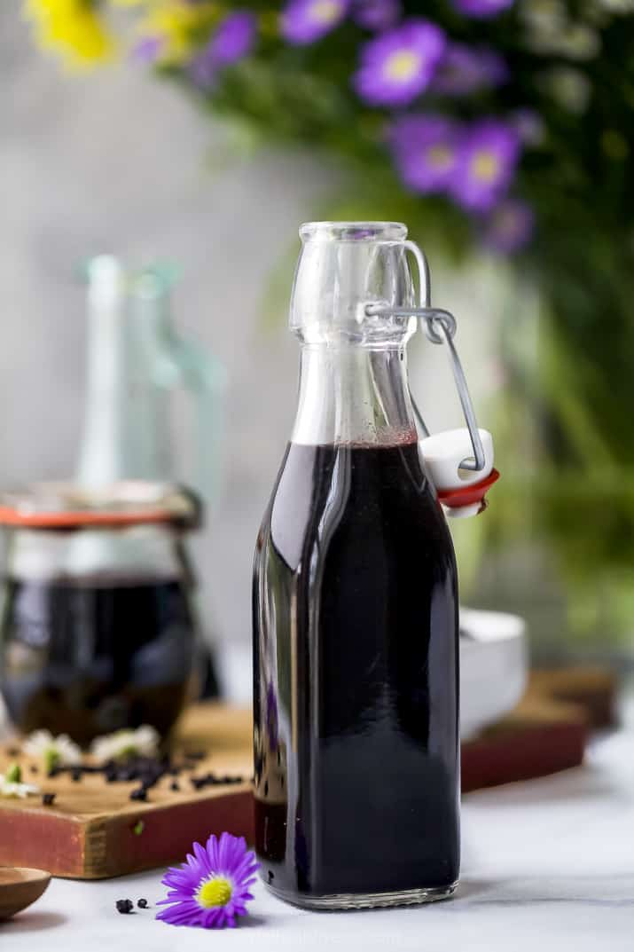 homemade elderberry syrup in a container