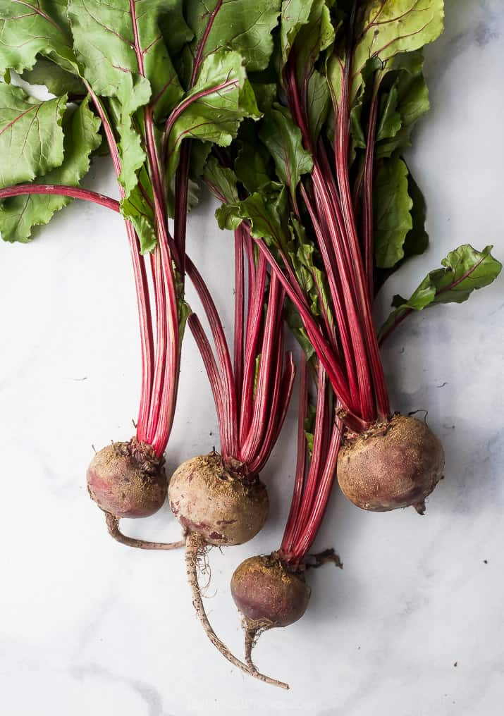raw beets on a board