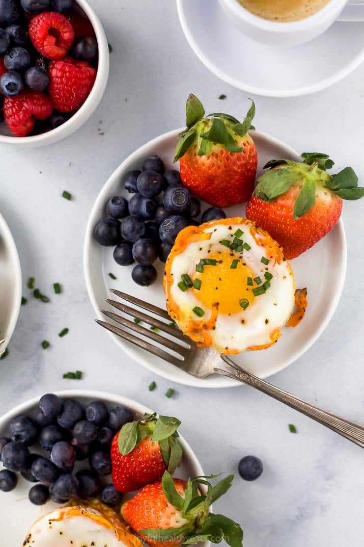 close up photo of sweet potato hash baked egg cups with fresh fruit