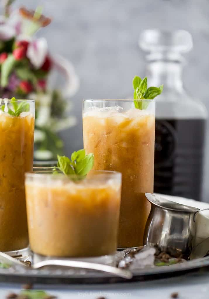 easy coconut milk thai iced coffee in a glass with mint