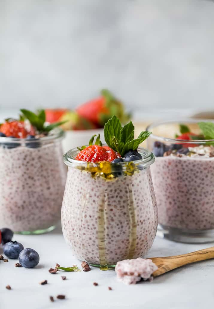 creamy strawberry chia pudding in a weck jar topped with fresh fruit