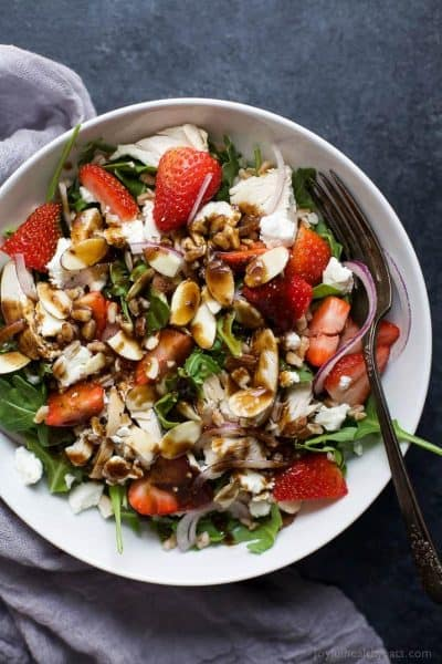 farro arugula strawberry chicken salad drizzled with balsamic dressing