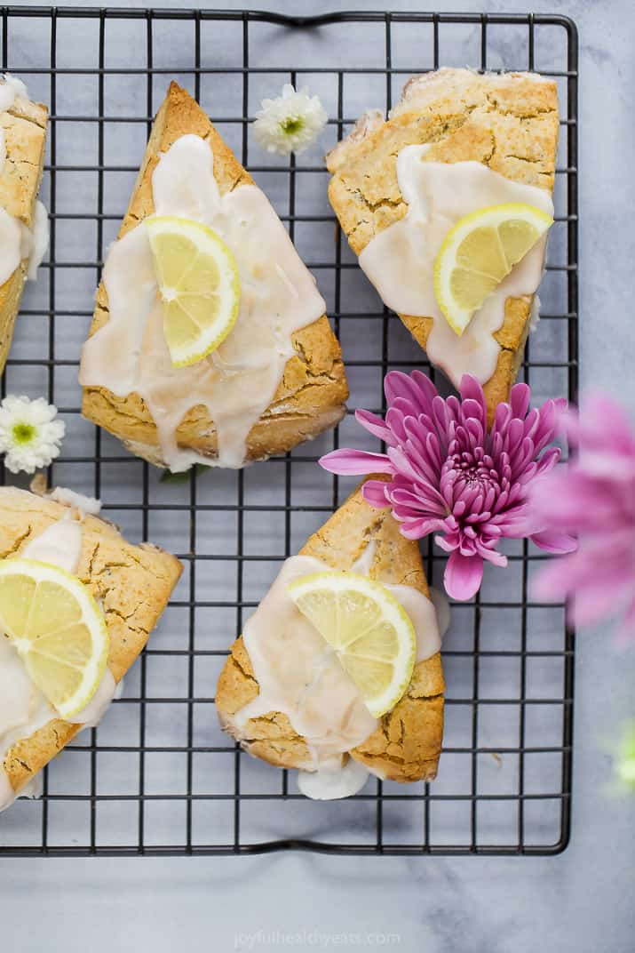 gluten free lemon poppy seed scones with a lemon glaze and lemon slice on top