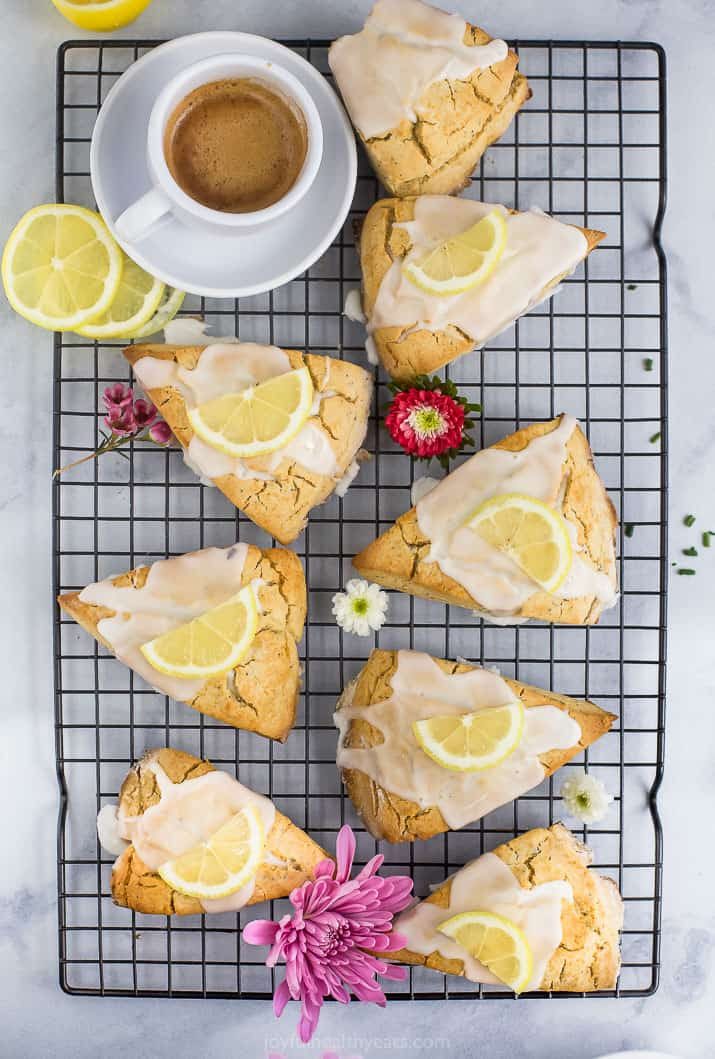 gluten free lemon poppy seed scones with a lemon glaze and lemon slice on top