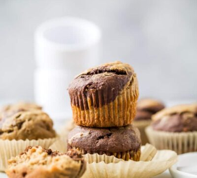 moist healthy marbled chocolate banana muffins stacked on top of each other