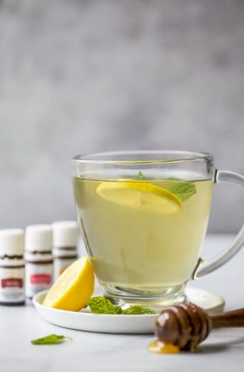 Wellness Thieves Tea in a cup with lemon