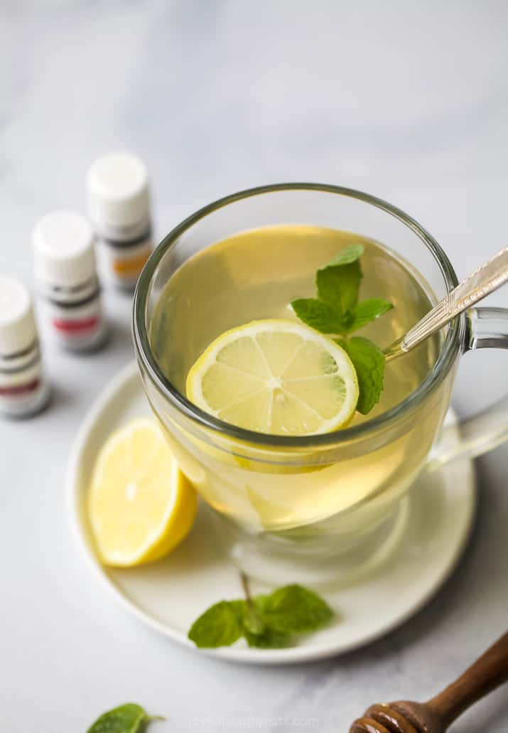 Thieves Tea in a cup with lemon