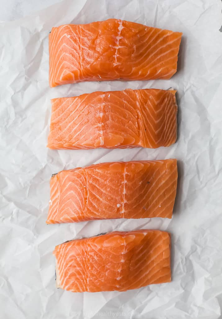 fresh salmon filets on parchment
