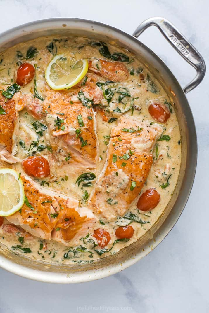 creamy tuscan pan seared salmon in a skillet