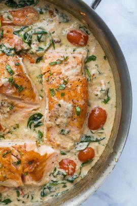 creamy tuscan pan seared salmon in a skillet