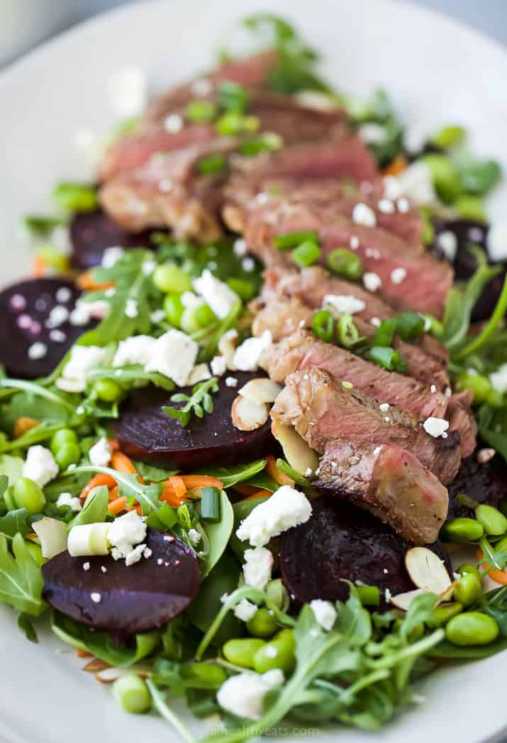 close up photo of pan seared steak on a roasted beet salad