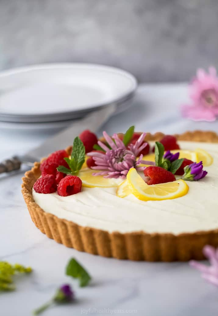 side angle of Creamy Lemon Tart Recipe with Almond Crust ready to be served