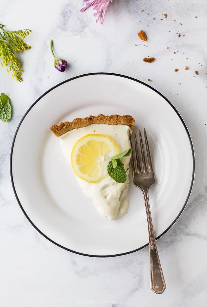 Creamy Lemon Tart Recipe with Almond Crust on a plate with a fork