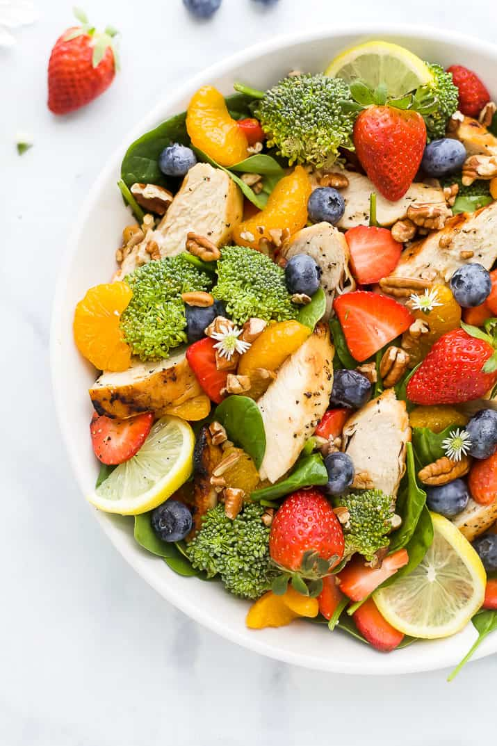 detox strawberry chicken salad with honey mustard dressing in a bowl