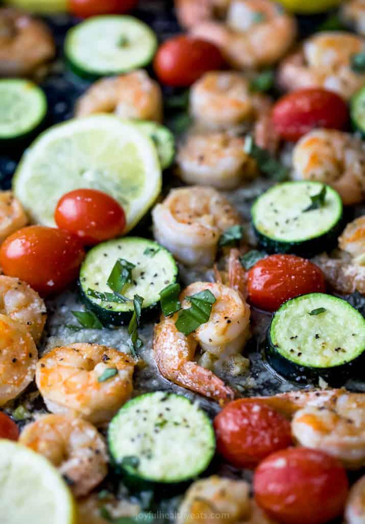 close up photo of Easy Garlic Parmesan Sheet Pan Shrimp and Zucchini on a pan
