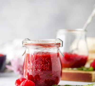 side photo of jar filled with Homemade Raspberry Jam Recipe