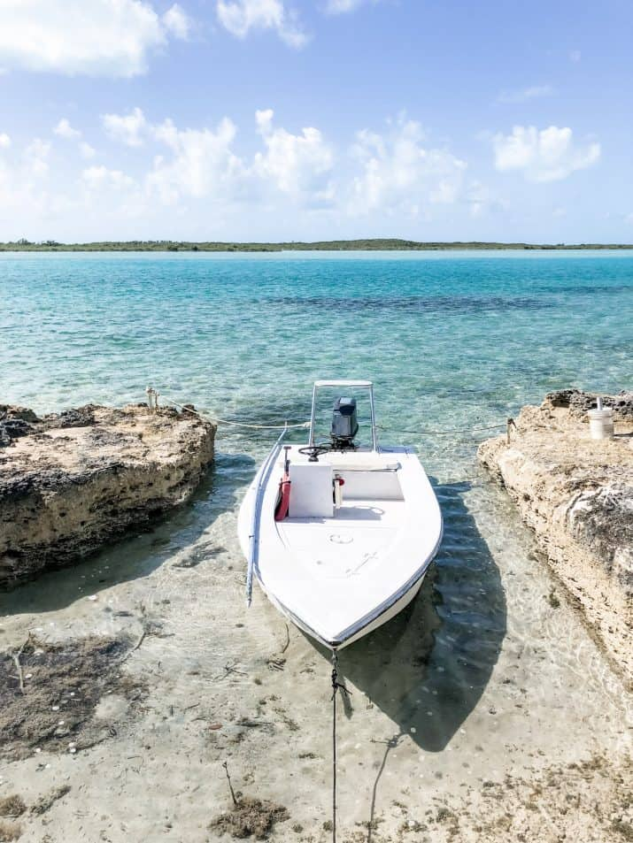 photo of a boat in aqua blue bahamas water
