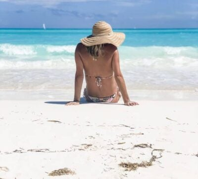 picture of a girl on a the beach with a hat