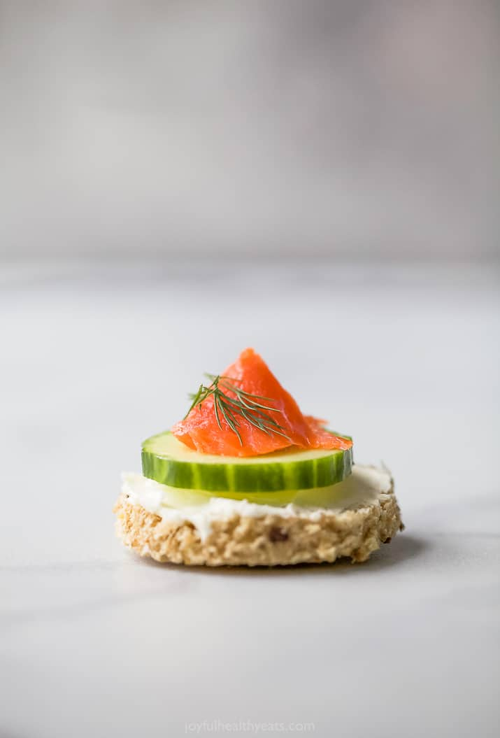 a single smoked salmon cucumber tea sandwiches