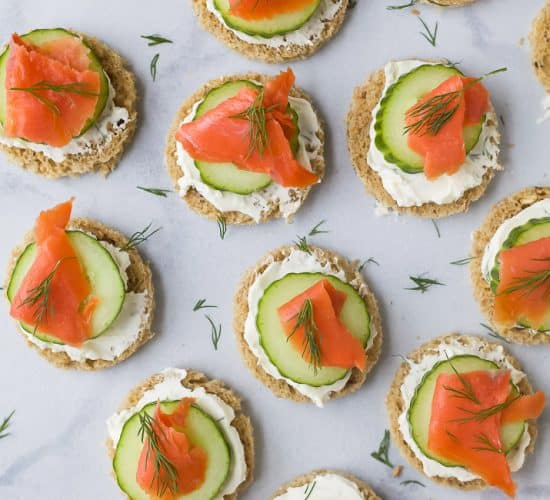 overhead photo of smoked salmon cucumber tea sandwiches