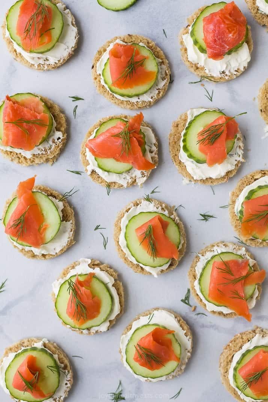 overhead photo of smoked salmon cucumber tea sandwiches