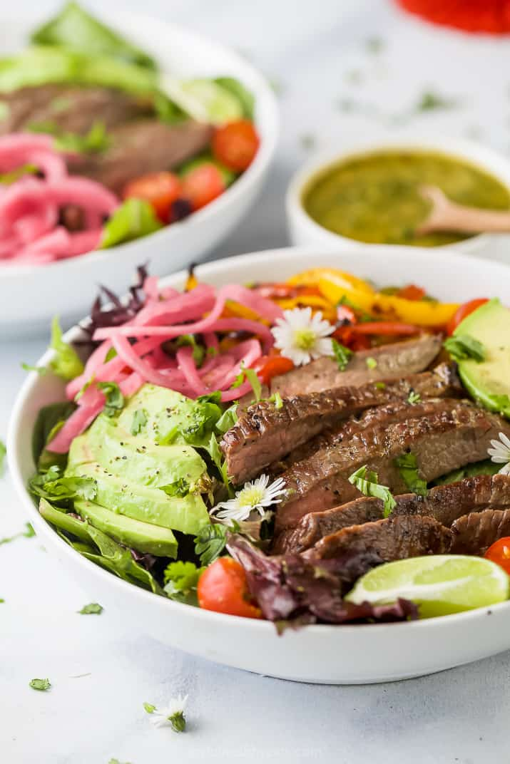 side photo of grilled fajita steak salad with chimichurri dressing