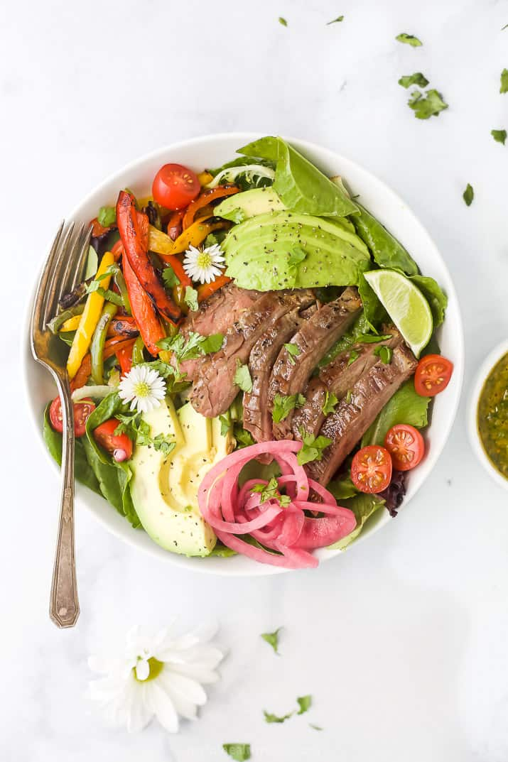overhead photo of grilled fajita steak salad with chimichurri dressing